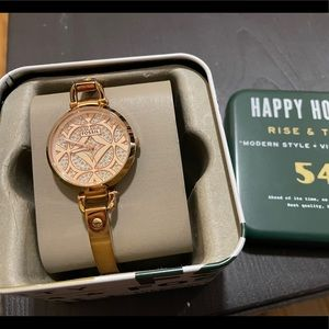 Rose Gold Fossil Watch with crystal face details